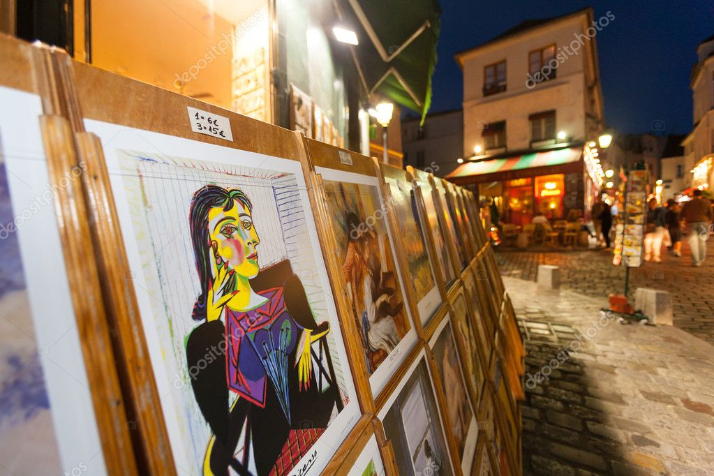 Picasso replica for sale at Montmartre in Paris at night time — Stock Photo #9060411
