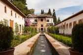Water feature and gardens of the Generalife inside the Alhambra — Stock Photo