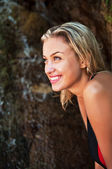 Attractive young blonde wet tanned girl smiling — Stock Photo