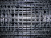 The metal mesh. Roll. — Stock Photo