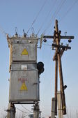 Transformer and a wooden electric pole. — Foto de Stock