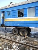 A rail wagon with car wheels. — Stock Photo