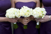 Bridesmaids with flowers — Stock Photo