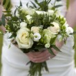 Bride holding bouquet of flowers — Stock Photo #10372046
