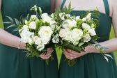 Bridesmaids hold flowers — Stock Photo