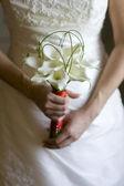 Bride with lily bouquet — ストック写真