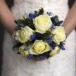 Wedding bouquet held by a bride — Stock Photo