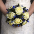 Stock Photo: Wedding bouquet held by a bride