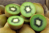 Green kiwi fruit and some cut ones — Stock Photo