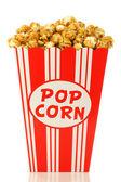 Caramel popcorn in a decorative paper popcorn cup — Stock Photo