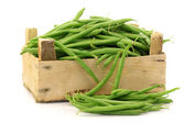 Bunch of green beans in a wooden box — Stock Photo