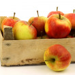 Fresh red and yellow apples in wooden box — Stockfoto #8919077
