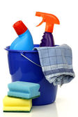 Blue plastic household bucket with two cleaning bottles — Stock Photo