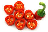 Cut red hot chili peppers (Capsicum) — Stock Photo
