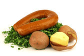 Freshly cut kale cabbage, some potatoes and a smoked sausage — Stock Photo