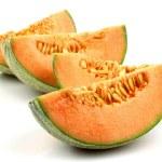 Four pieces of cantaloupe melon — Stock Photo #9087098