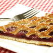 "Stock Photo: Slice of decorated cherry pie called ""vlaai"""
