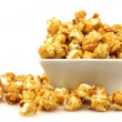 Pieces of caramel popcorn in a bowl - Stock Photo