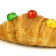 Freshly baked croissant bread with colorful conserved fruits — Stock Photo