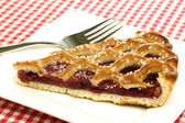 "Slice of decorated cherry pie called ""vlaai"" — Stock Photo"