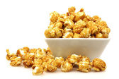 Pieces of caramel popcorn in a bowl — Stock Photo