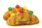 Freshly baked croissants bread with colorful conserved fruits — Stock Photo