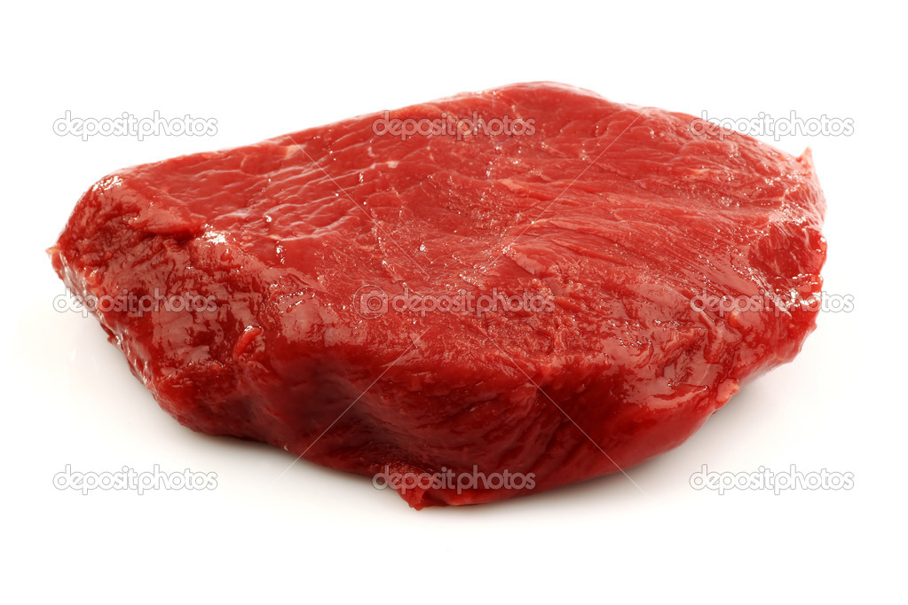 Fresh red beefsteak on a white background   Stockfoto #9087313