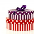 Red and purple striped gift boxes — Stock fotografie