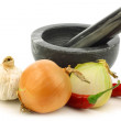 Mortar and pestle and some fresh vegetables — Stock Photo #9133861