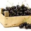 Stock Photo: Fresh delicious cherries in wooden box