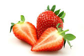 Fresh strawberry and two halves — Stock Photo
