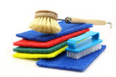 Abrasive pads and two household brushes — Stock Photo
