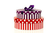 Red and purple striped gift boxes — Stock Photo