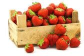 Fresh strawberries in a wooden box — Stock Photo