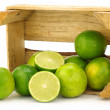 Stock Photo: Fresh lime fruit in a wooden crate