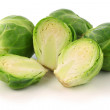 Freshly cut brussel sprouts and some whole ones - Stockfoto