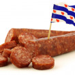 Traditional frisian dried sausage pieces with a dutch flag toothpick - Stock Photo