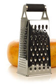 Modern metal cheese grater and a whole dutch edam cheese — Stok fotoğraf