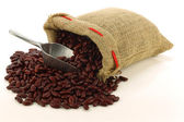Red kidney beans in a burlap bag and an aluminum scoop — Stock Photo