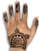 Henna design on the palm of the hand — Stock Photo