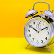 Alarm Clock - Orange and yellow background — Stock Photo