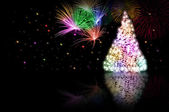 Christmas tree - color - and fireworks — Stock Photo