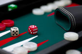 Backgammon case, shaker and dice — Stock Photo