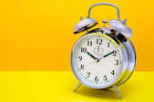 Alarm Clock - Orange and yellow background — Stok fotoğraf
