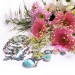 Flowers and jewelry — Stock Photo
