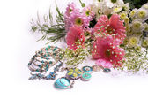 Flowers and jewelry — Stok fotoğraf