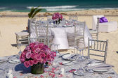 Table on the beach — Stock Photo