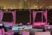 Beach with coloured cushion and Dubai on the background. — Stock Photo