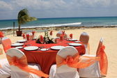Outdoor wedding table by the beach — Stock Photo