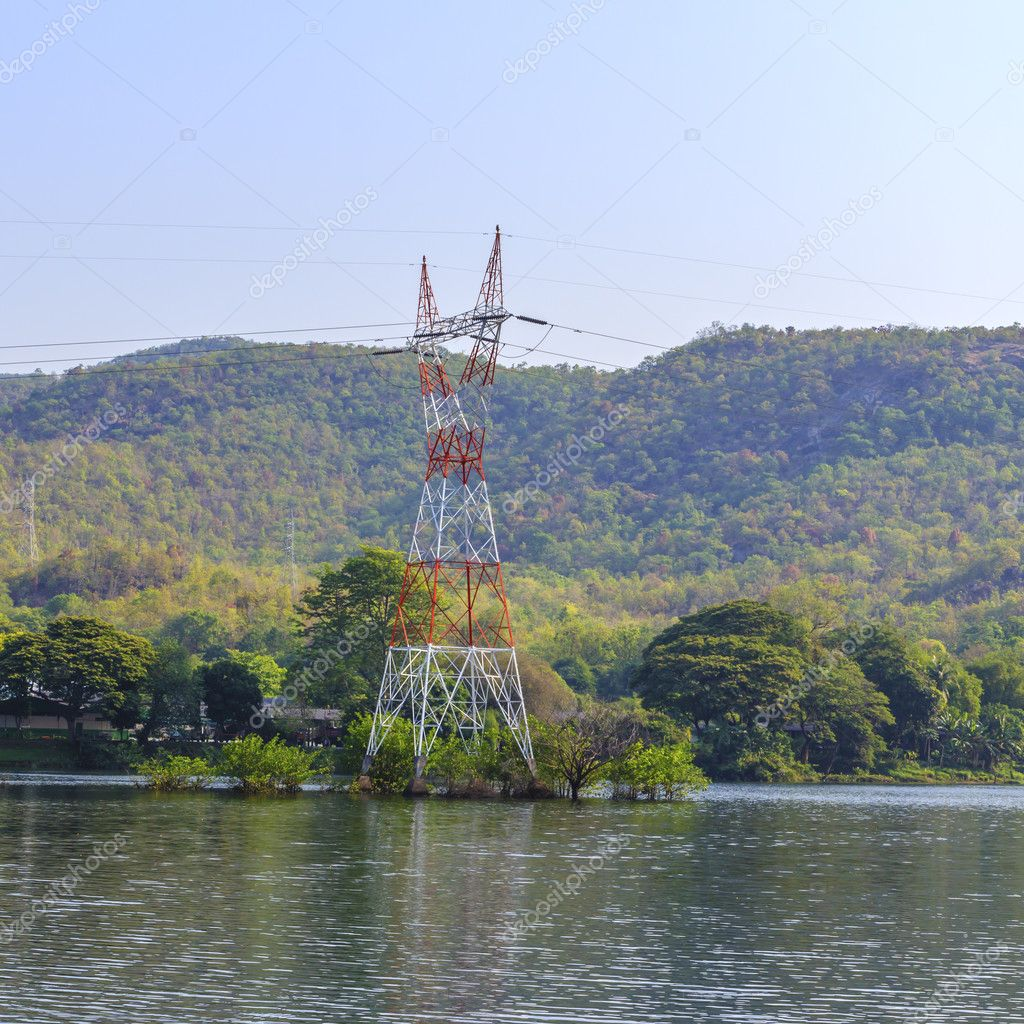 High voltage towers. Transmission of electricity from the dam. — Stock Photo #10108836